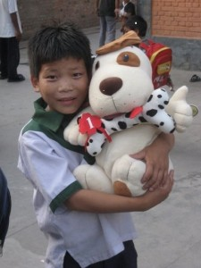 Happy boy receives his first stuffed toy dog!